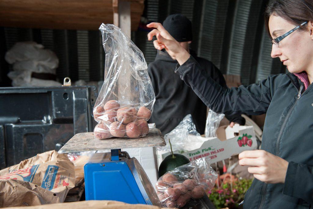 Vanessa weighing potatoes